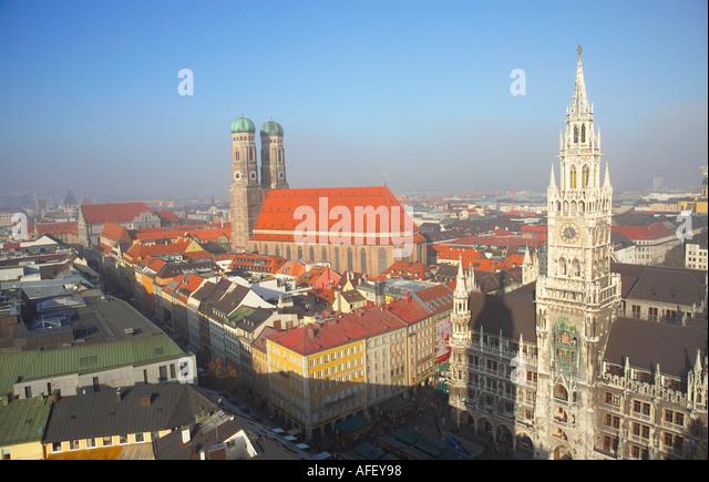 Germany Bavaria Bayern Munich Marienplatz Frauenkirche left and Neues Rathaus right - Stock Image