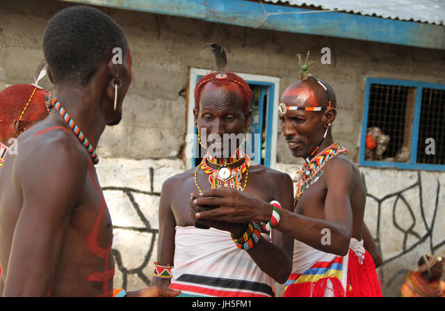 LOIYANGELENI, KENYA - May 18. A Rendile tribesman reacts with excitement on seeing his photo taken on a mobile phone - Stock Image