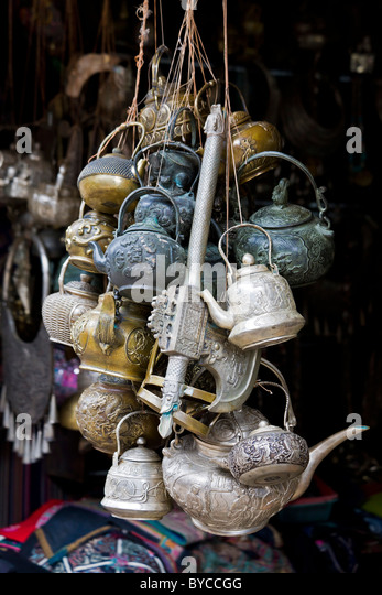 Ornate metal teapots and axe in Lijiang old town, Yunnan Province, China. JMH4771 - Stock Image