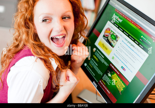 Girl online using computer - Stock Image