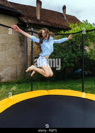 cute teens on trampoline
