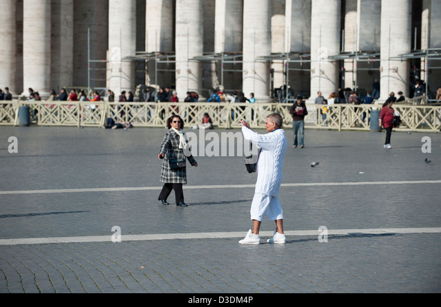 Tourist take a photo in St Peter's Square. - Stock Image