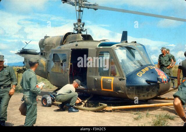 US army soldiers look at Bravo Troop, 1st Squadron, 9th Cavalry, 1st Cavalry Division helicopter gunship crashed. - Stock Image