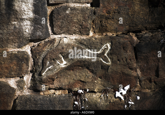 Dolphin carved into the stone facade of Cheesden Lumb Lower Mill Cheesden Valley near Heywood Lancashire UK - Stock Image