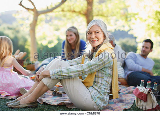 Family picnicking together outdoors - Stock-Bilder