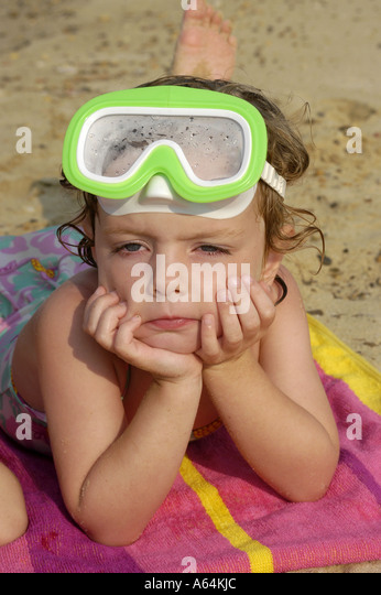 Young girl beach towel beaches - Stock Image