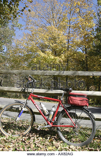 West Virginia Lewisburg Greenbrier River Trail bicycle fence fall colors trees - Stock Image