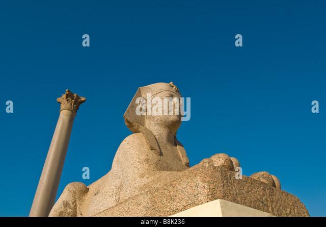 Sphinx Pompeys Pillar Alexandria Egypt historic monument tourist attraction iconic egyptian symbol - Stock Image
