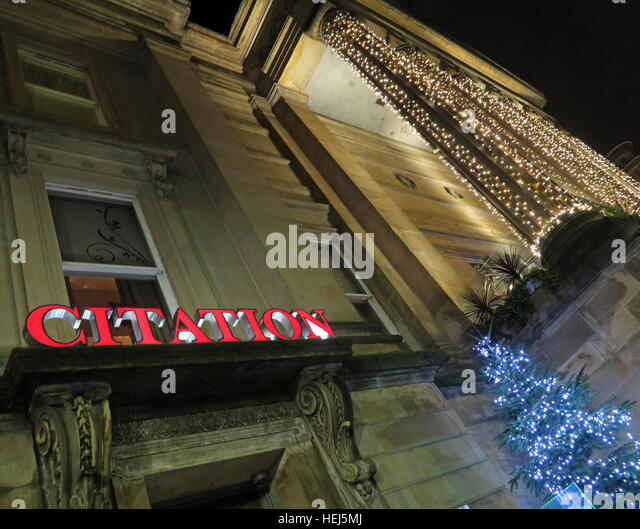 Glasgow buildings of the Merchant City,Scotland,UK at night - The Citation Bars - Stock Image