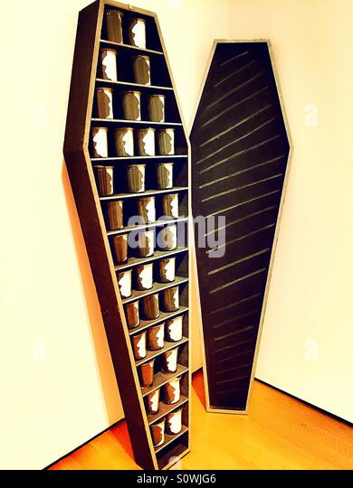 Coffin and glass mug display in a museum - Stock Image