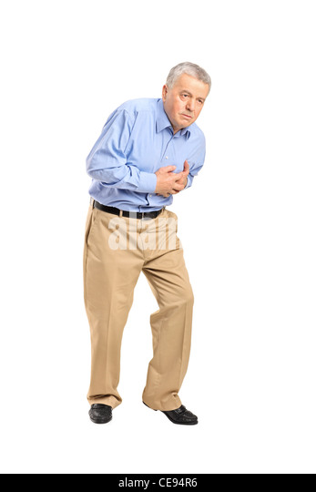 Senior man having a heart attack - Stock Image