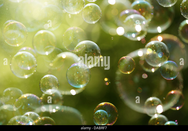 Summer sunlight and soap bubbles - Stock Image