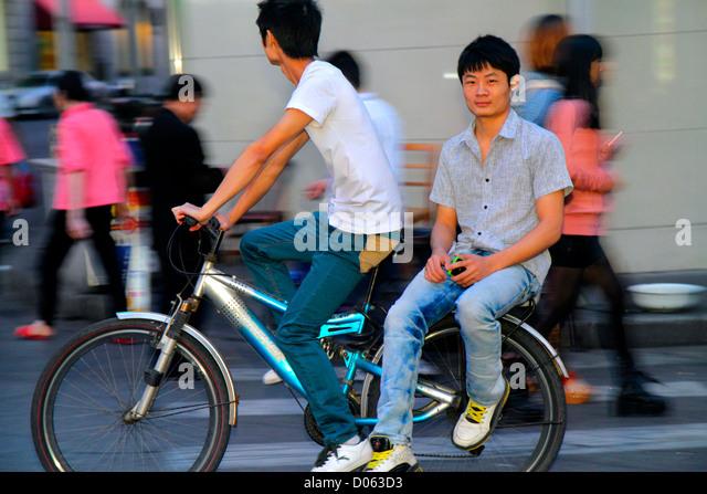 China Shanghai Huangpu District Sichuan Road traffic bicycle Asian man motion - Stock Image