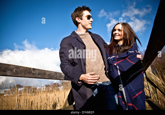 Romantic couple strolling on footbridge - Stock-Bilder