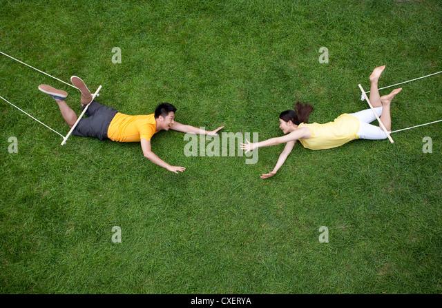 Creative young couple imitating aerialist - Stock-Bilder
