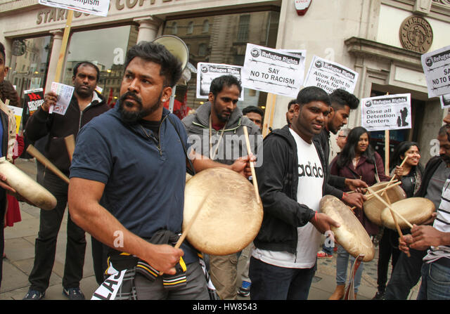 London, UK. March 18, 2017: Indian immigrants drum and chant as they prepare to participate in the Stand Up To Racism - Stock Image