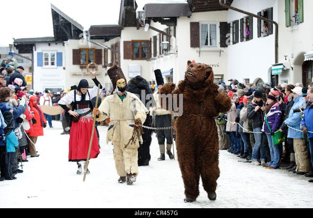 Men dressed in traditional carnival costumes, carnival parade, Maschkera, Mittenwald, Werdenfelser Land, Upper Bavaria - Stock Image