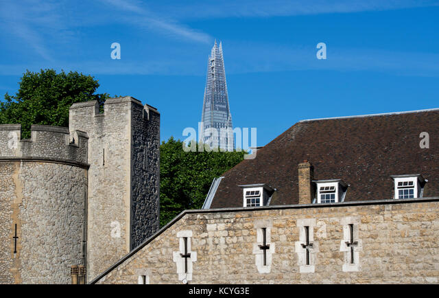 Walls of the Tower of London in London, England, UK, with the Shard in the background - Stock Image