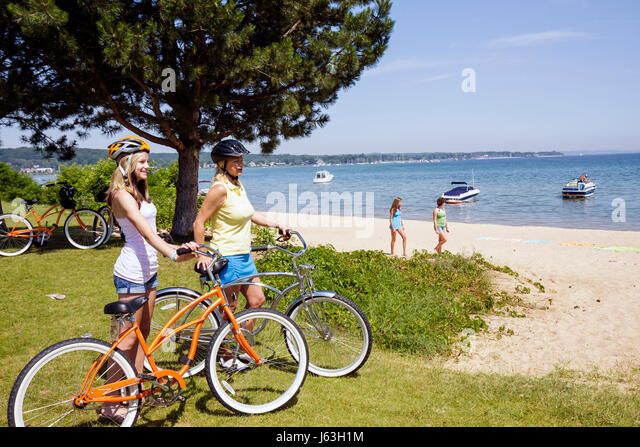 mom and daughter biking stock photos mom and daughter. Black Bedroom Furniture Sets. Home Design Ideas