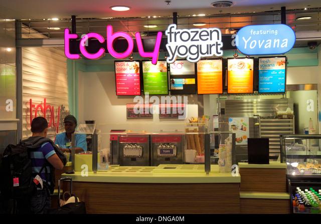 Charlotte North Carolina Charlotte Douglas International Airport CLT terminal concourse gate area TCBY Frozen Yogurt - Stock Image