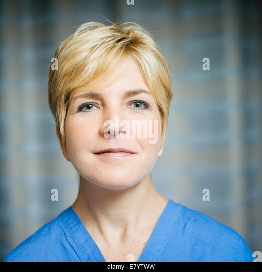 Portrait of doctor in scrubs - Stock Image