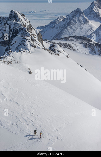 Men skiing in East Greenland - Stock Image
