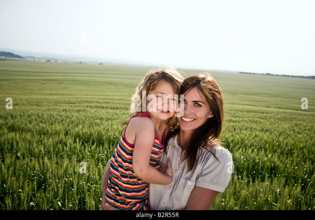 Woman and child in wheat-field - Stock Image