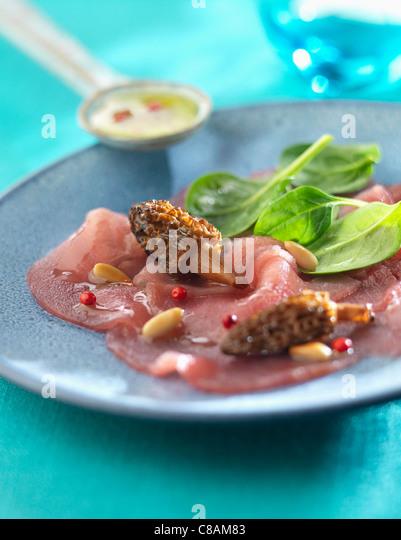 Red tuna Carpaccio with morels - Stock Image