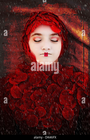 Girl dressed in Red  Rose Pedals - Stock-Bilder