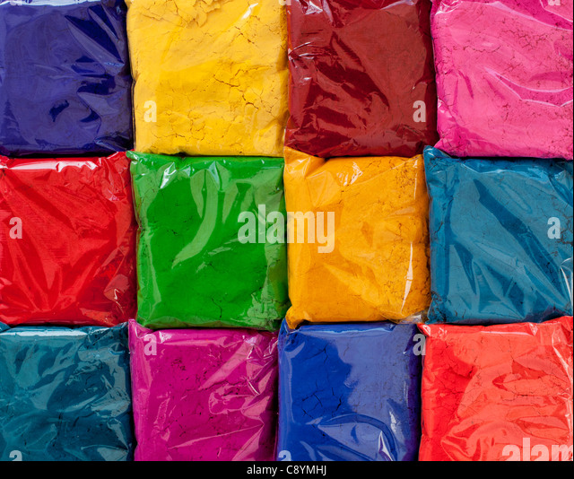 Bags of Indian coloured powder used for amking rangoli designs on the street. India - Stock Image