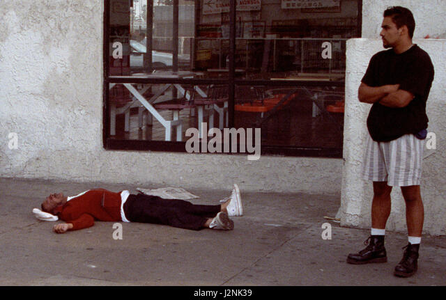April 29/May 4 1992. Los Angeles CA. Coverage as man lies dead from the Los Angeles riots after the not guilty acquittal - Stock Image