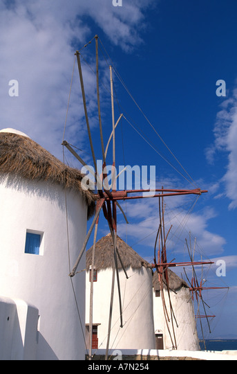 GREECE Mykonos white windmills thatch roof national symbol iconic image blue sky background - Stock Image