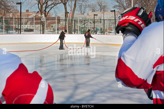 Workers Resurface Ice Hockey Rink - Stock Image
