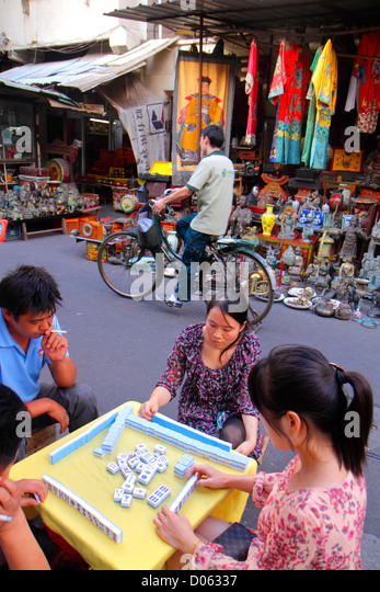Shanghai China Huangpu District Dongtai Road shopping antiques collectibles vendor for sale display Asian woman - Stock Image
