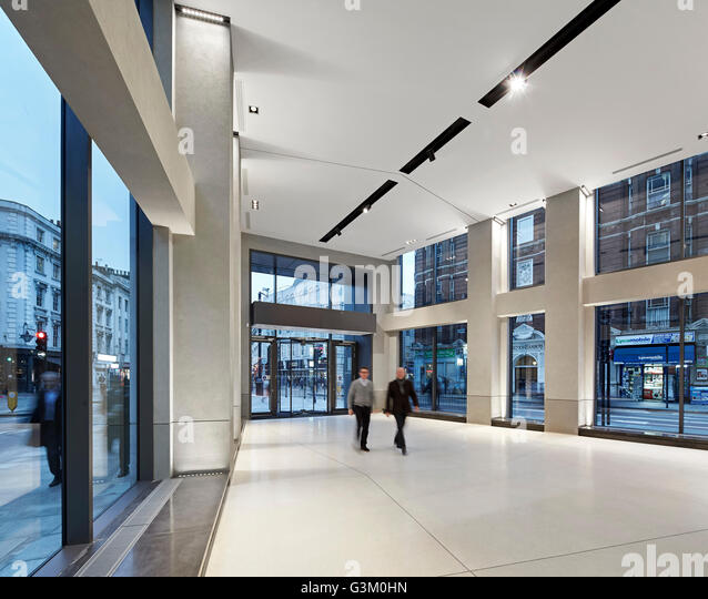 Double-height entrance with ample glazing and street view. Bloomsbury Way, London, United Kingdom. Architect: BuckleyGrayYeoman, - Stock Image