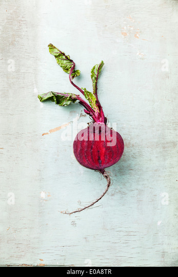 Ripe beet with leaves on textured background - Stock Image