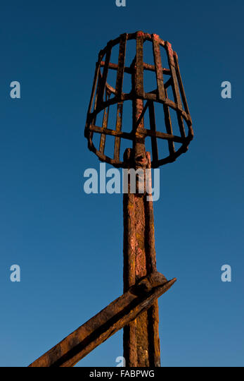 Rusty beacon attached to the groins along the shoreline of Dovercourt, Essex, UK - Stock Image