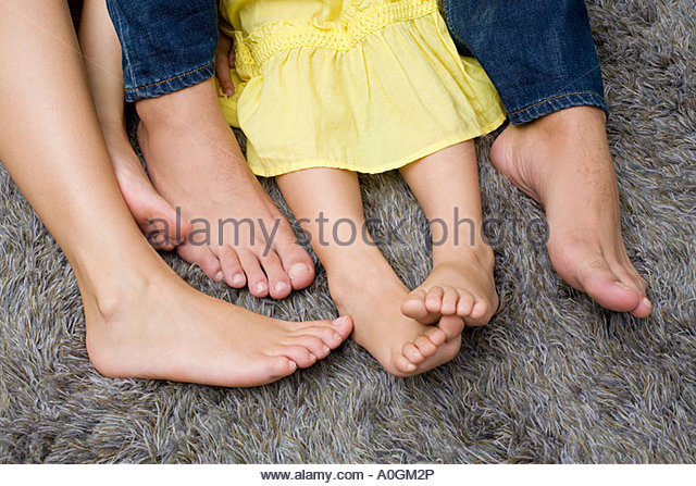 Legs of a girl and her parents - Stock Image