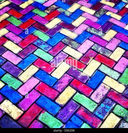 A colorful brick sidewalk. Amsterdam Netherlands Europe. - Stock Image