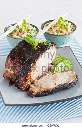 Glazed roast pork with cantonese rice - Stock Image