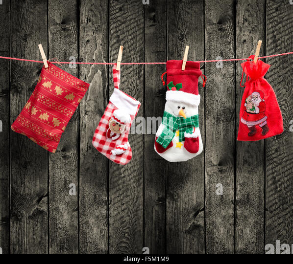 Santa's bag on the clothesline, with wood background - Stock Image