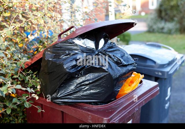 overflowing wheelie bin lid open rubbish waste bin liverpool uk - Stock Image