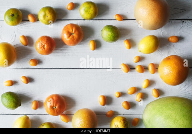 Frame of autumn gifts on the wooden table top view - Stock Image
