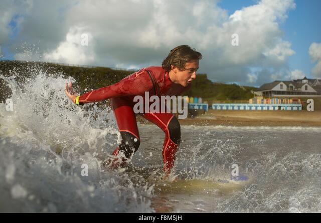 Teenage boy, surfing - Stock Image
