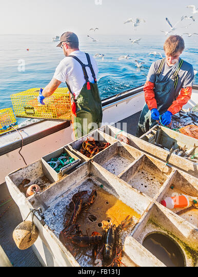 Fishermen working on boat - Stock Image