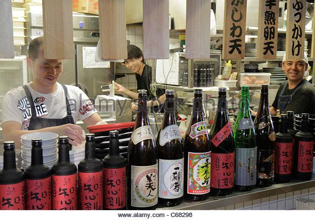 Japan Tokyo Akihabara Asian man men workers restaurant kitchen cook kanji hiragana katakana characters symbols Japanese - Stock Image