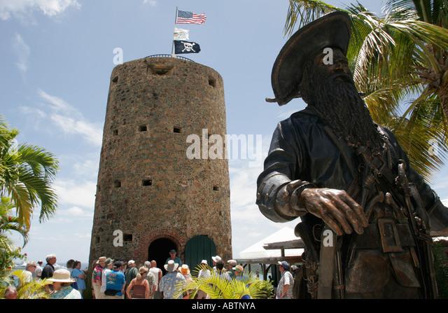 St. Thomas USVI Charlotte Amalie Blackbeard's Hill pirate statue Skytsborg Tower built 1678 tour group - Stock Image