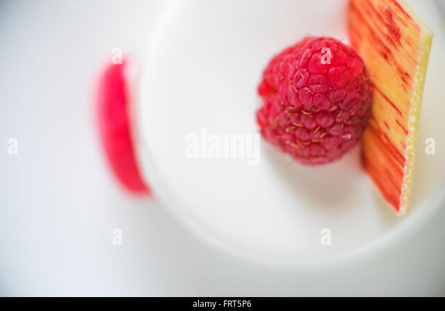 White cake with raspberry close-up - Stock Image
