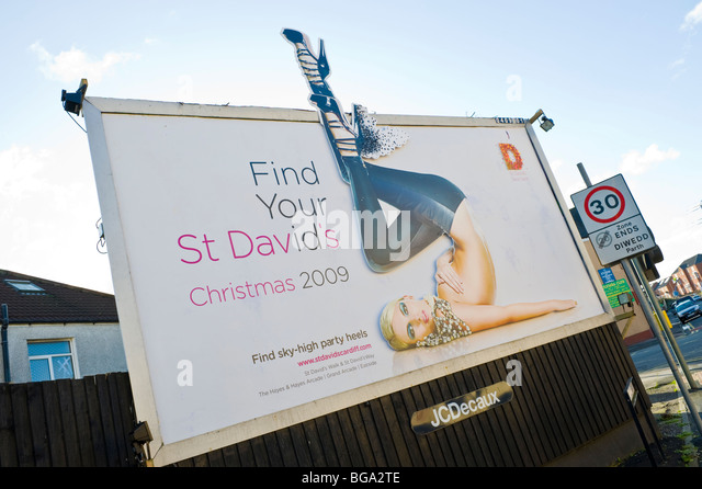 JCDecaux billboard site featuring poster for St David's Shopping Centre Cardiff in Newport South Wales UK - Stock Image