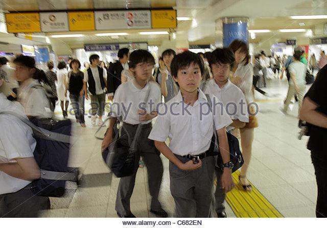 Japan Tokyo Ikebukuro JR Ikebukuro Station train subway Asian adolescent boy student commuters group crowd - Stock Image